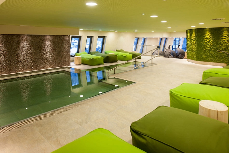 Green-Interiors-of-the-Refreshing-Spa-with-Green-Fabric-Chaises going green in interiors - Green Interiors of the Refreshing Spa with Green Fabric Chaises - Going Green in Interiors – JD Institute