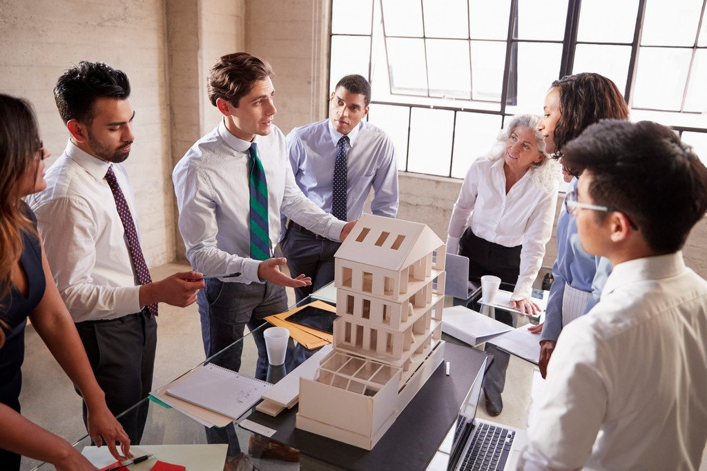 Carve your own space with BSc in Interior design and Decoration interior design - architect presenting a design model to business co P5JEX34 - Carve your own space with BSc in Interior design and Decoration