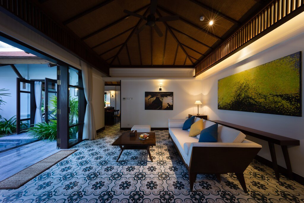 Different types of lighting are incorporated into a living room based on the needs and preferences of the clients. types of lighting - Types of lighting used in living room interior design THUMBNAIL - Types of lighting used in living room interior design
