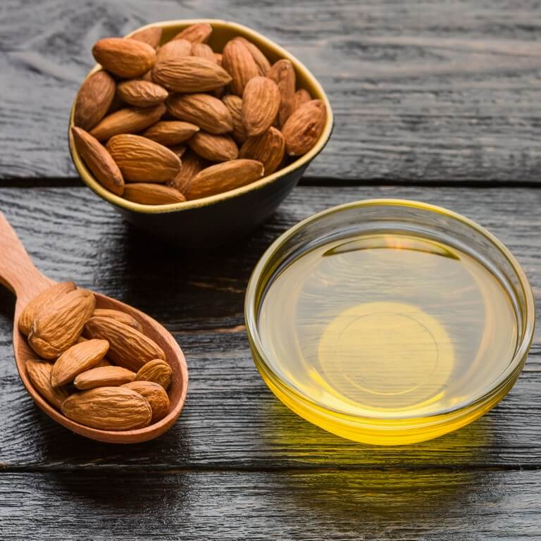 HAIR OILS: HOW IS IT BENEFICIAL? hair oils - almond - HAIR OILS: HOW IS IT BENEFICIAL?