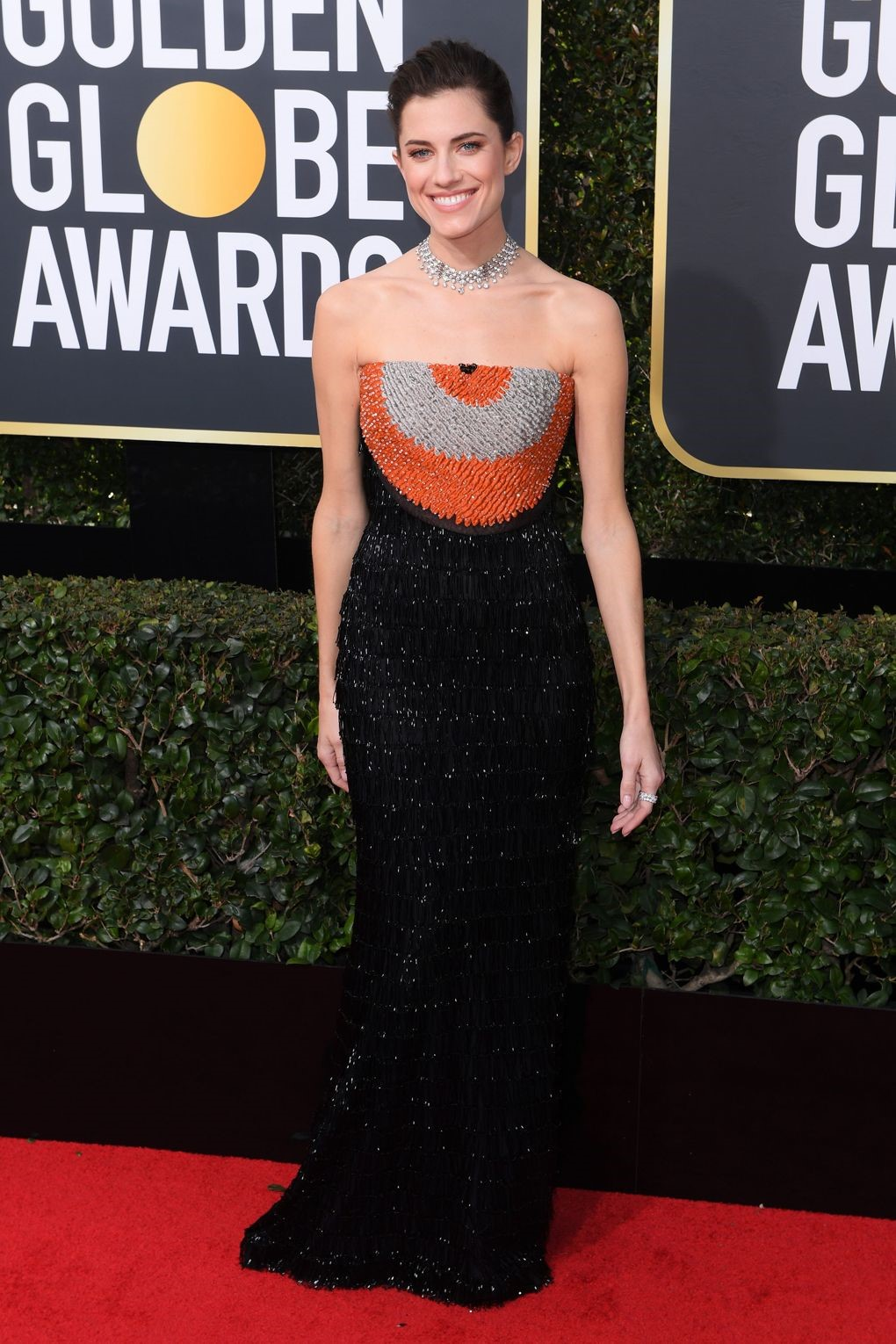 Allison Williams made a splash with this orange and black alluring Armani Prive. golden globes 2018 JD's top 13 red carpet looks of Golden Globes 2018 10