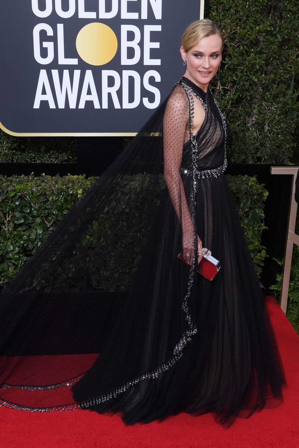Diana Kruger stood out in Prada Gown making her look like the queen of the red carpet. golden globes 2018 JD's top 13 red carpet looks of Golden Globes 2018 11