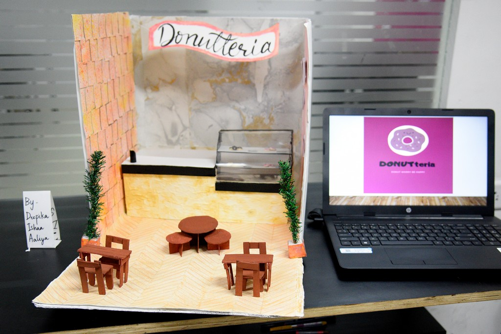 students of interior design display miniature retail space layouts STUDENTS OF INTERIOR DESIGN DISPLAY MINIATURE RETAIL SPACE LAYOUTS STUDENTS OF INTERIOR DESIGN DISPLAY MINIATURE RETAIL SPACE LAYOUTS 3